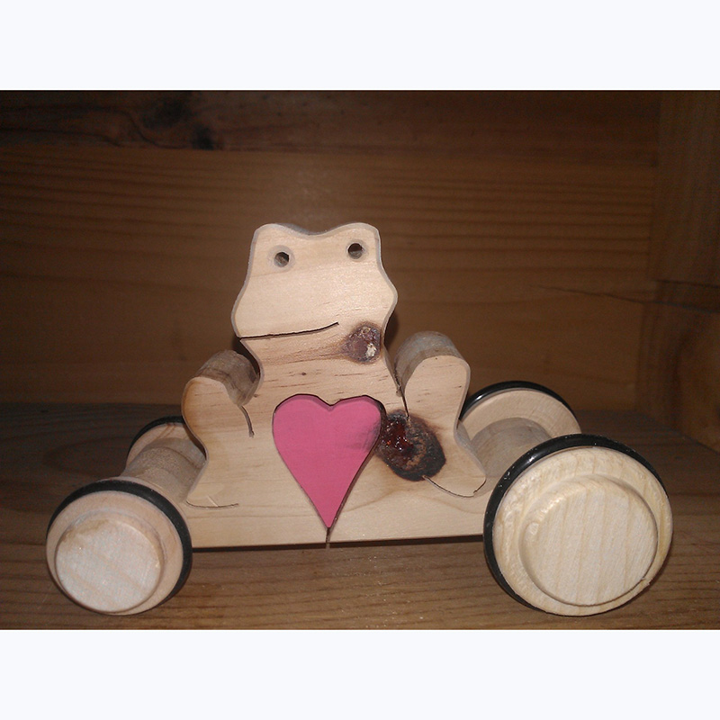 Frog with heart on wheels