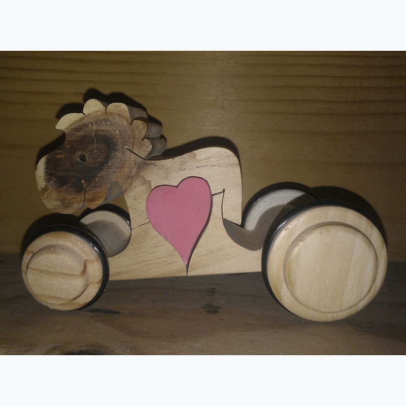 Horse with heart on wheels